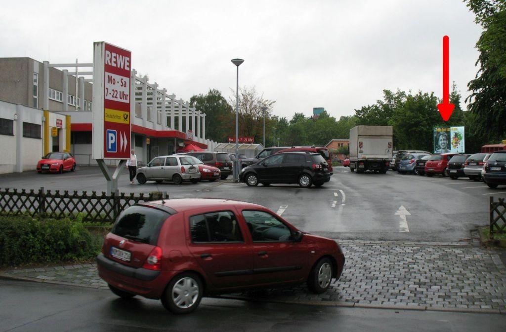 Graf-Otto-Str. 10. REWE gg.Eingang
